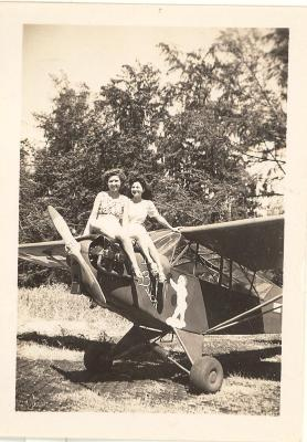"Blase Camacho and a friend sitting on top of an airplane named ""Baby Butch"""