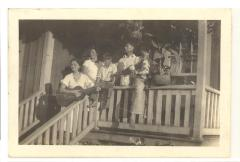 Blase, Mary, Gus, Lawrence Sr., and Bernard playing music on the porch