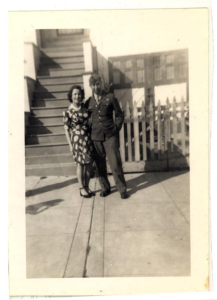 Daniel Camacho posing with a woman in his World War II service uniform
