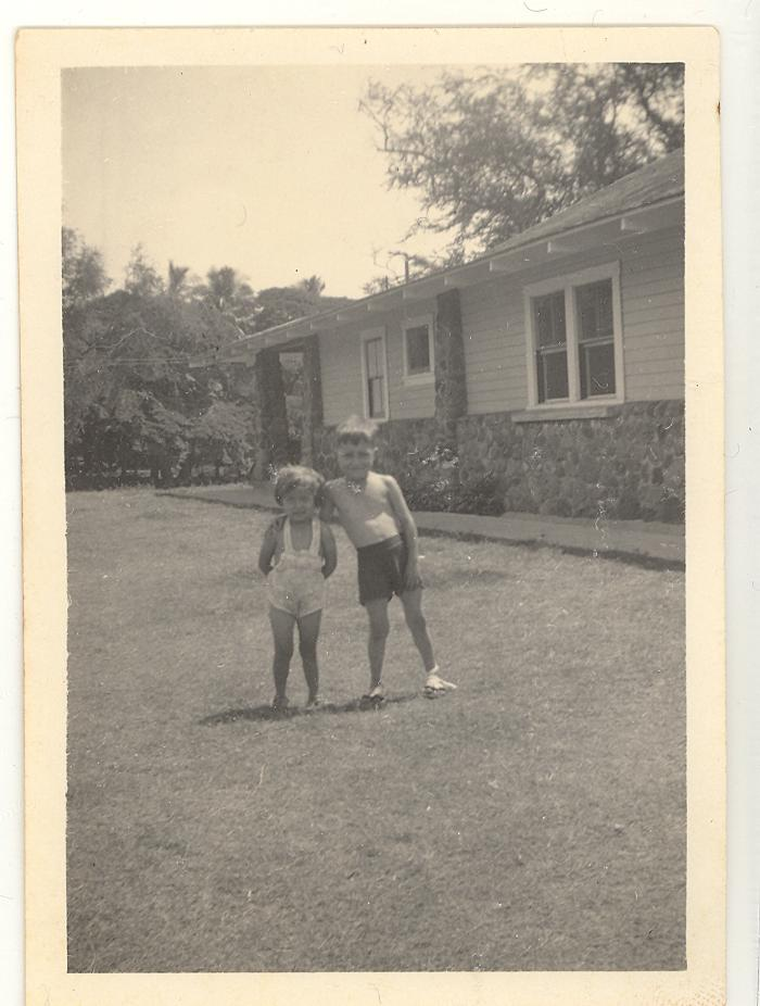 Larry Camacho and a relative in the backyard