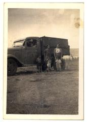 Benito Torres and his truck with Mary, Beatrice, and children