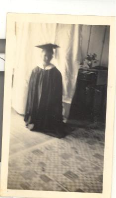 Larry Camacho in graduation robe