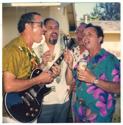 Members of the Camacho Caravalho family playing music