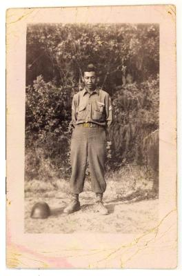 Daniel Camacho in his World War II service uniform in a field
