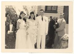 Blase Camacho, Christine Santiago, and Bernard Camacho outside the church during the wedding ceremony