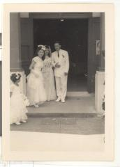 Blase Camacho, Christine Santiago, and Bernard Camacho outside the church after the wedding ceremony
