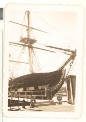 Blase Camacho in front of a large wooden ship