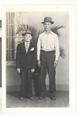 Two men in hat and suit