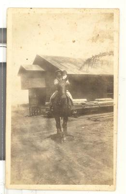 Caravalho man on a horse with child