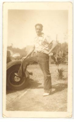 Marco Torres, Sr. resting foot on car wheel