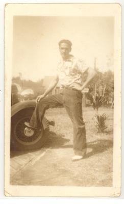 Marco Torres, Sr. resting foot on car wheel