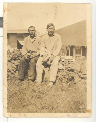 Two men sitting on a ledge