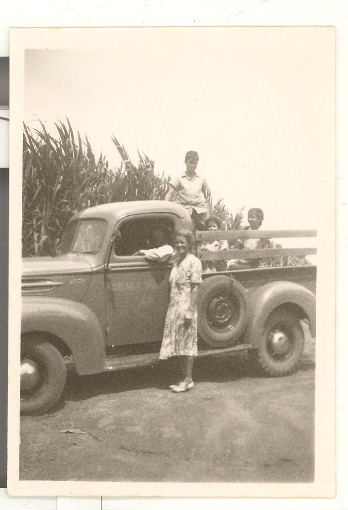 Family on a truck in a sugar cane field