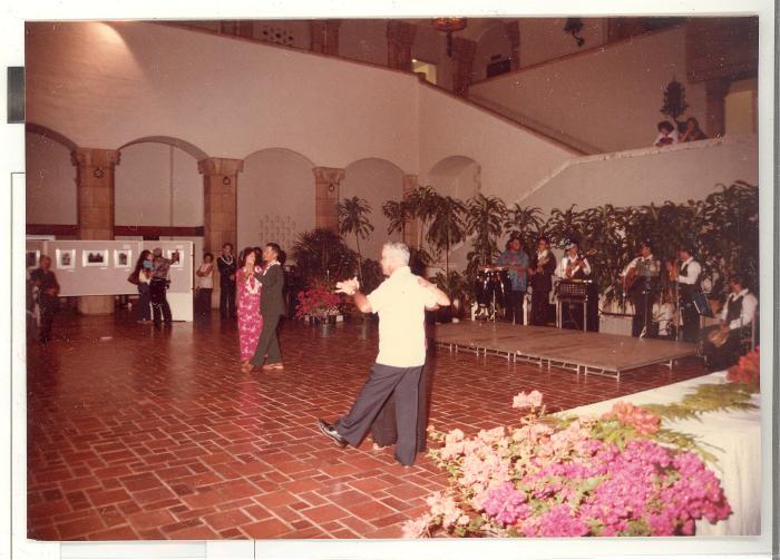 Attendees dancing during opening reception of Boricua Hawaiiana exhibit
