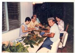 Group at table making pasteles
