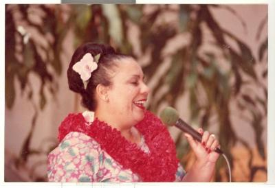 Singer performing at Boricua Hawaiiana opening reception