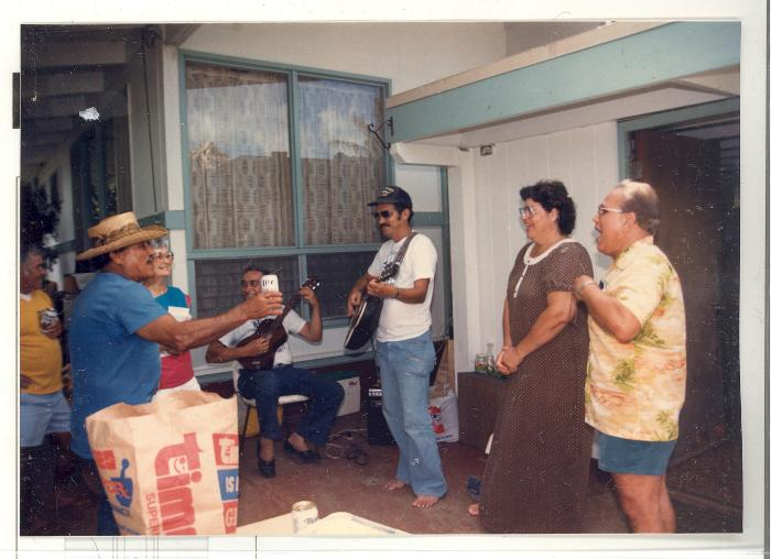 Blase Camacho and company singing and playing music