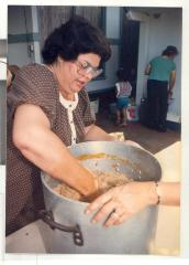 Woman cooking filling for pasteles
