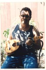John Ogao holding a heart-shaped ukulele