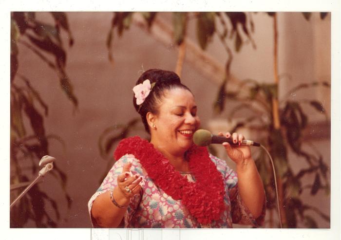 Singer performing at Boricua Hawaiiana opening reception