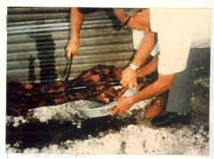 Serving the roasted pig cooked by Albert Montalbo