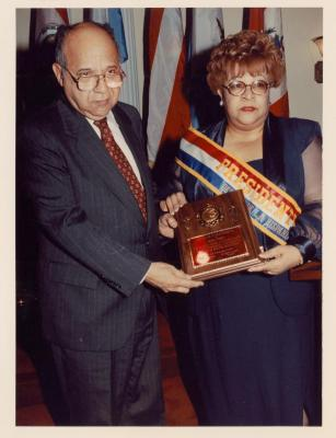 Hispanic Day Parade President Elena Martos presents award to State Assemblyman Frank Torres