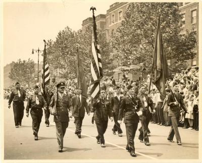 American Legion members from Post No. 1216 marching at a parade in the Bronx
