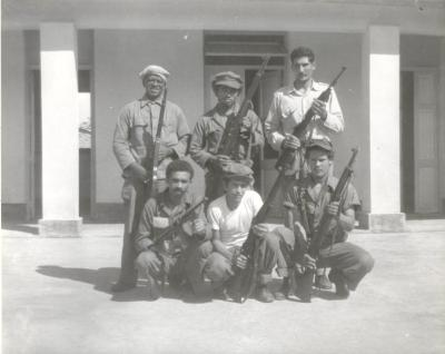 Militants posing with weapons