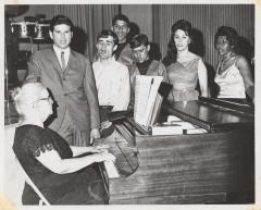 Pianist Genoveva de Arteaga with a group of singers