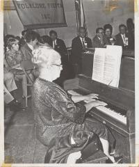 Pianist Genoveva de Arteaga performs on the piano during Folklore Fiesta, Inc, New York, NY