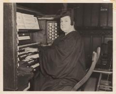 Musician Genoveva de Arteaga performs on an organ