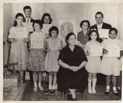 Puerto Rican pianist Genoveva de Arteaga with a group of young people holding a certificate