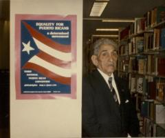 Justo A. Martí in the stacks of the Center for Puerto Rican Studies Library