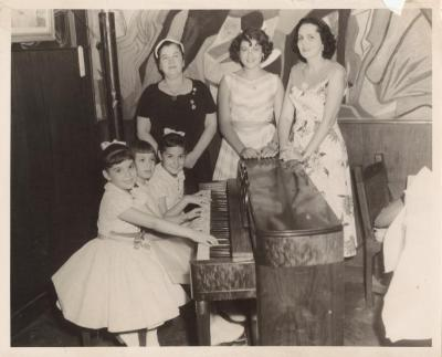 Musician Genoveva de Arteaga (top left) with piano students