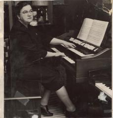 Musician Genoveva de Arteaga plays the organ