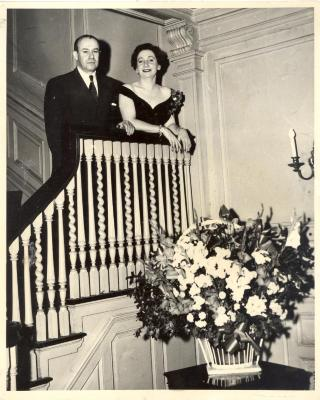 Juan Avilés and an unidentified woman atop a staircase
