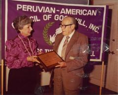 Photograph of Juan Avilés receiving an award from the Peruvian-American Council of Goodwill