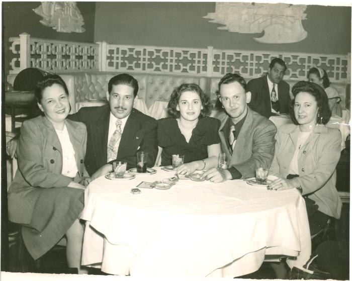 Juanita Arocho, Homero Rosado, and Friends at a Restaurant
