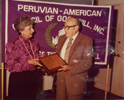 Photograph of Juan Avilés receiving an award from the Peruvian-American Council of Goodwill