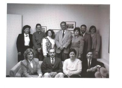 Louis Nuñez (center in suit) and others