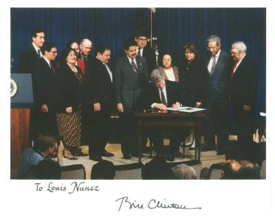 President Bill Clinton signing a document