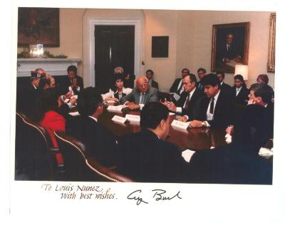 President George H.W. Bush in a business meeting