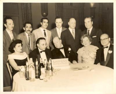Ramón Colón at a formal dinner with others