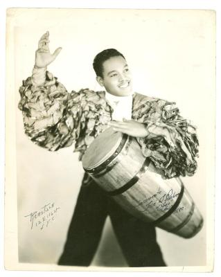 "Jose ""Cheo"" Pacheco in rumbero outfit playing a conga drum"