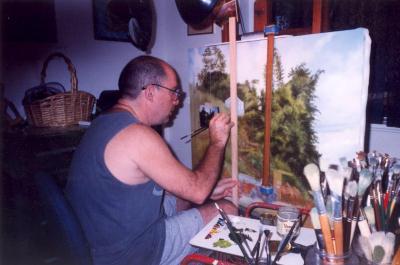 Samuel García at work on his painting
