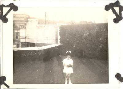 Little girl on rooftop