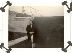 Older woman standing on rooftop in post-World War II period