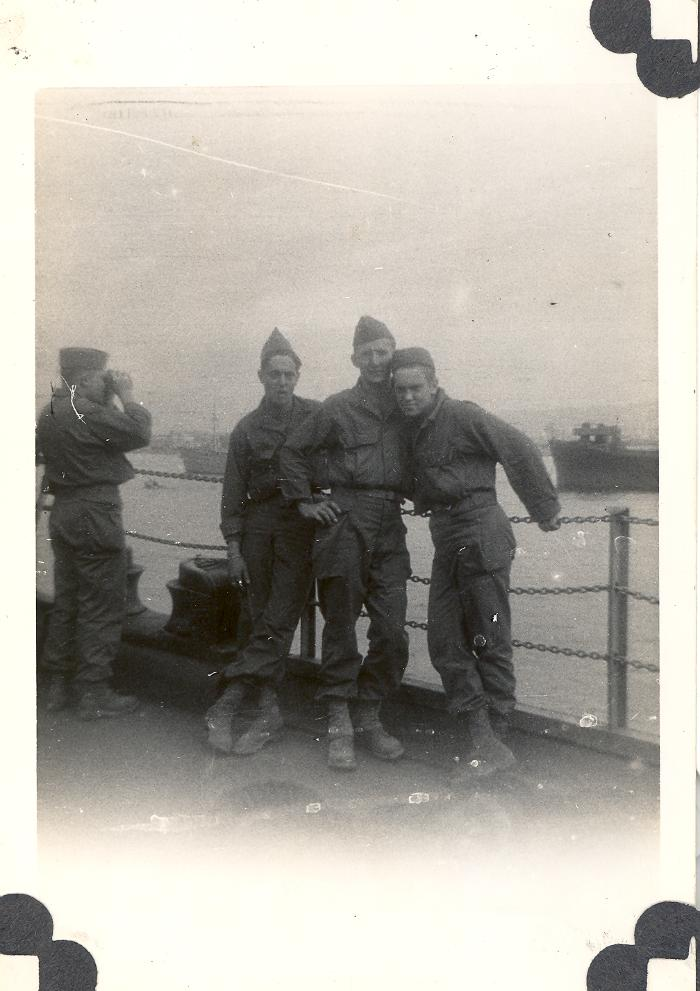 Soldiers on a military ship during World War II period