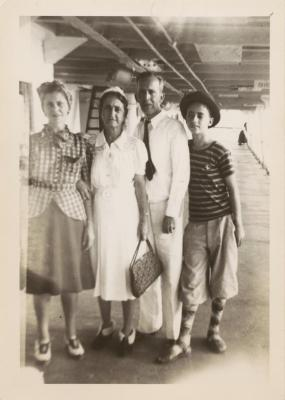 Maria Luisa Ortiz and husband Gerardo Torres (wearing white) pose with other passengers on steamship deck