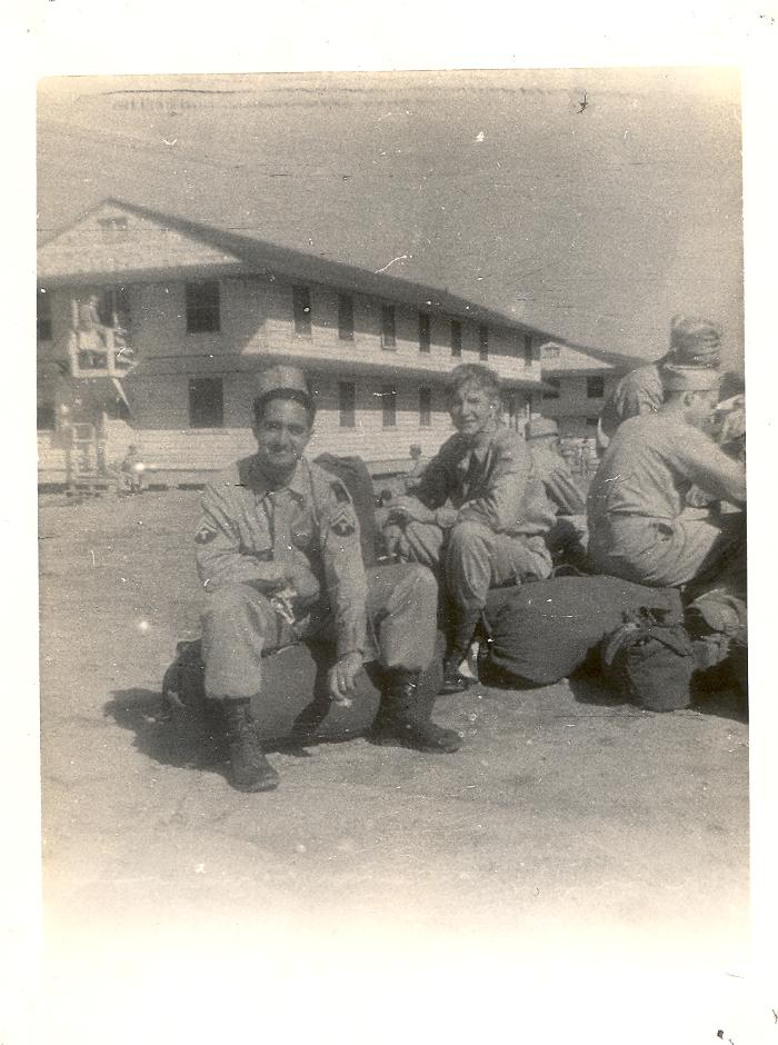 Soldiers sitting on their packs during World War II period